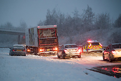 © Licensed to London News Pictures. 10/12/2017. Bourne End, UK. Police attend the scene of an incident on the A41 near Bourne End in Buckinghamshire where vehicles have spun on the road in heavy snow. The A41 north bound is currently closed. Parts of the south east of England are blanketed with snow for the first time this winter. Photo credit: Ben Cawthra/LNP