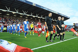 The Bristol teams walk out onto the pitch  - Photo mandatory by-line: Dougie Allward/JMP - Tel: Mobile: 07966 386802 04/09/2013 - SPORT - FOOTBALL -  Ashton Gate - Bristol - Bristol City V Bristol Rovers - Johnstone Paint Trophy - First Round - Bristol Derby
