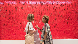 "© Licensed to London News Pictures. 28/06/2018. LONDON, UK. Visitors share a conversation in front of ""State of Being"", 2016, by Chiharu Shiota. Members of the public visit Masterpiece London, the world's leading cross-collecting art fair held in the grounds of the Royal Hospital Chelsea.  The fair brings together 160 international exhibitors presenting works from antiquity to the present day and runs 28 June to 4 July 2018.  Photo credit: Stephen Chung/LNP"