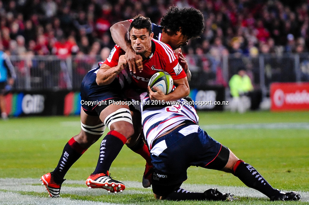 Dan Carter of the Crusaders  is tackled by Lopeti Timani  and Paul Alo-Emile of the Rebels in the Super Rugby match, Crusaders v Rebels at AMI Stadium, Christchurch, New Zealand 13 February 2015. Photo:John Davidson/www.photosport.co.nz