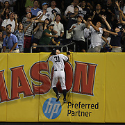 Ichiro Suzuki, New York Yankees, watches a home run from Brayan Pena, Cincinnati Reds, sail over the right field wall during the New York Yankees Vs Cincinnati Reds baseball game at Yankee Stadium, The Bronx, New York. 18th July 2014. Photo Tim Clayton