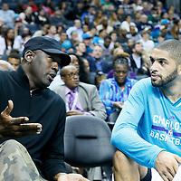 03 November 2015: Michael Jordan is seen talking to Charlotte Hornets forward Nicolas Batum (5) during the Charlotte Hornets  130-105 victory over the Chicago Bulls, at the Time Warner Cable Arena, in Charlotte, North Carolina, USA.