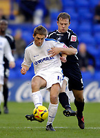 Photo: Jed Wee.<br />Tranmere Rovers v Swansea City. Coca Cola League 1.<br />26/11/2005.<br />Tranmere's Danny Harrison (L) tries to hold off Swansea's Kristian O'Leary.