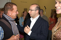 Left to right, NICKY HASLAM and PAUL McKENNA at a party to celebrate the publication of 'You Are Here' by Rory Bremner, Juhn Bird and John Fortune held at the National Portrait Gallery, St.Martin's Place, London on 1st November 2004.<br />