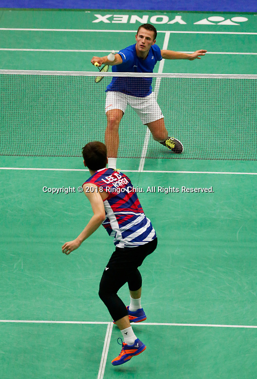 Mark Caljouw (top) of Netherland, competes with Lee Dong Keun of Korea, during the men's singles final match at the U.S. Open Badminton Championships in Fullerton, California, on June 17, 2018. Lee won 2-1. (Photo by Ringo Chiu)<br /> <br /> Usage Notes: This content is intended for editorial use only. For other uses, additional clearances may be required.