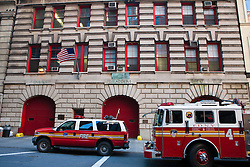New York Fire Department station with fire trucks and fire engine, Manhattan, New York City, New York.
