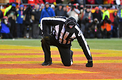 Jan 19, 2020; Kansas City, Missouri, USA; NFL back judge Perry Paganelli (46) gets to his feet after being hit on a play during the AFC Championship Game between the Kansas City Chiefs and Tennessee Titans at Arrowhead Stadium. Mandatory Credit: Denny Medley-USA TODAY Sports