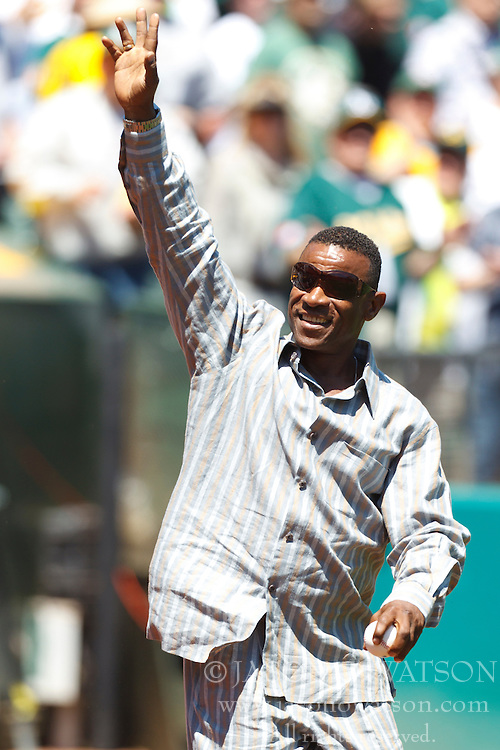 April 30, 2011; Oakland, CA, USA;  Former Oakland Athletics outfielder Rickey Henderson waves to fans before throwing out the ceremonial first pitch before the game against the Texas Rangers at Oakland-Alameda County Coliseum.