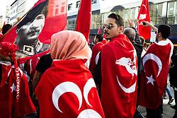 19.10.2014, Muenchen, GER, Aufmarsch von tuerkischen Nationalisten gegen die PKK, Der Rockerclub 'Turkos MC' rief zu einer Demonstration gegen die PKK auf. Laut Polizeiangaben hatte der Aufmarsch 200 Teilnehmer, weitere 50 Rocker fuhren auf Motorraedern vorneweg. Ein Grossteil der Teilnehmer trug Symboliken der nationalistischen 'Grauen Woelfe' und der MHP, viele zeigten immer wieder den sog. 'Wolfsgruss', im Bild hen 'Grauen Woelfe' und der MHP, viele zeigten immer wieder den sog. 'Wolfsgruss'. ---Demoteilnehmer tragen Fahnen der Tuerkei, der MHP und grauen Woelfe als Umhaenge // during a parade by Turkish nationalists against the PKK. Rockers of 'Turcos MC' called for a demonstration against the PKK. According to police, the march had 200 participants, another 50 Rocker went on motorcycles in front. A majority of the participants wore symbolism of the nationalist 'Grey Wolves' and the MHP, many showed again the so-called 'Wolf greeting', Munich, Germany on 2014/10/19. EXPA Pictures © 2014, PhotoCredit: EXPA/ Eibner-Pressefoto/ Gehrling<br /> <br /> *****ATTENTION - OUT of GER*****