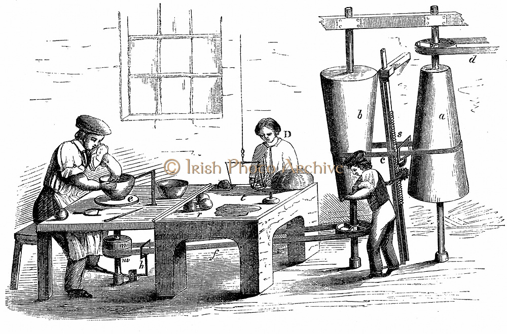 Throwing an earthenware vessel. Belt-driven wheel of type used at Wedgwood & Copeland factories . Speed of wheel regulated by boy by raising or lowering belt on conical drums. Baller is weighing clay for the next item to be made. Wood engraving c1860