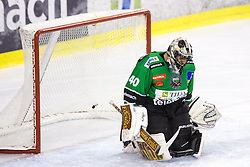 28.09.2014, Hala Tivoli, Ljubljana, SLO, EBEL, HDD Telemach Olimpija Ljubljana vs HC TWK Innsbruck, 6. Runde, im Bild Andy Chiodo (HDD Telemach Olimpija, #40) and puck the net // during the Erste Bank Icehockey League 6th round match betweeen HDD Telemach Olimpija Ljubljana and HC TWK Innsbruck at the Hala Tivoli in Ljubljana, Slovenia on 2014/09/28. EXPA Pictures &copy; 2014, PhotoCredit: EXPA/ Sportida/ Matic Klansek Velej<br /> <br /> *****ATTENTION - OUT of SLO, FRA*****