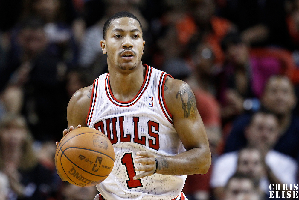 29 January 2012: Chicago Bulls point guard Derrick Rose (1) brings the ball up court during the Miami Heat 97-93 victory over the Chicago Bulls at the AmericanAirlines Arena, Miami, Florida, USA.