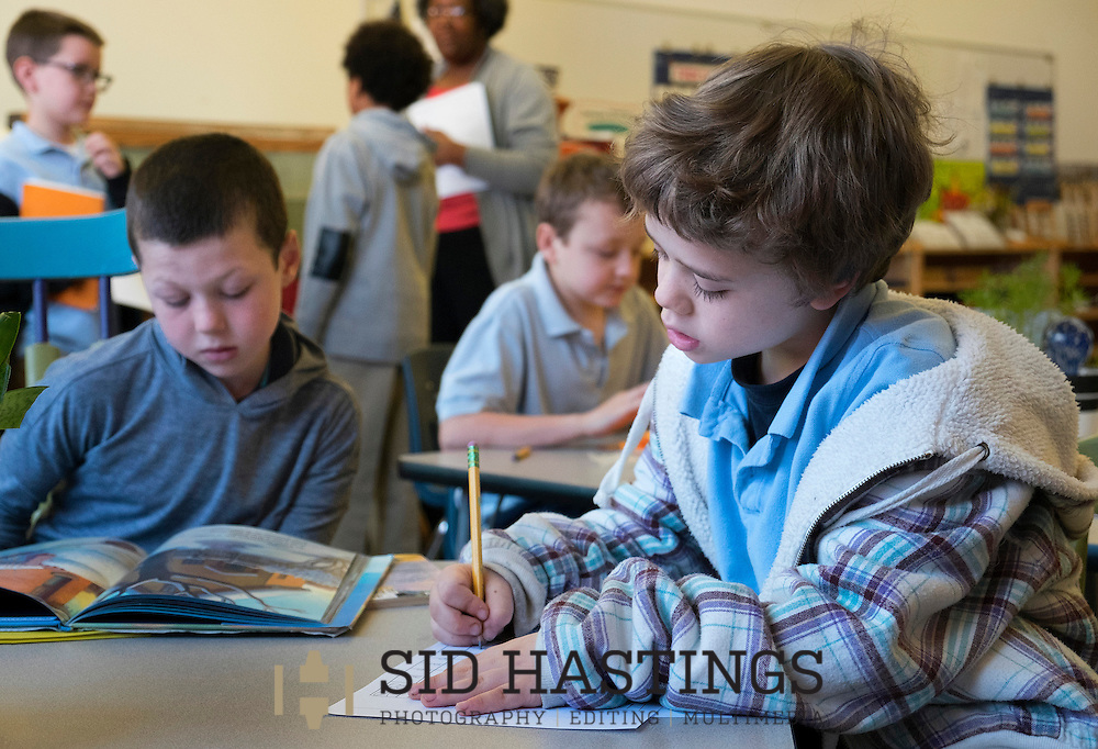 29 Feb. 2016 -- ST. LOUIS -- City Garden Montessori School students Linden Long (left) and Alden Needham, students in the &quot;The Crew of 321,&quot; join others in studying during class at the school in St. Louis Monday, Feb. 29, 2016. According to Dr. Nicole Evans, City Garden principal, the class includes students who in a traditional school would be in first, second and third grades. City officials report that success of the school, which serves students in the Shaw, Botanical Heights, Forest Park Southeast, Tiffany and Southwest Garden neighborhoods, has resulted in expanded home renovation and construction in some of the neighborhoods served.<br /> <br /> Photo &copy; copyright 2016 Sid Hastings.
