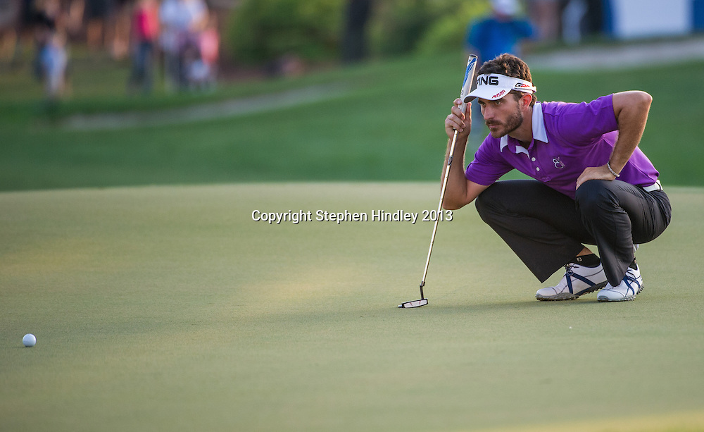 Alejandro Canizares of Spain studies the green before his final putt of the second round of the DP World Tour Championship held at the Jumeirah Golf Estates in Dubai, United Arab Emirates, on Friday, November 15, 2013.  Photo by: Stephen Hindley/SPORTDXB
