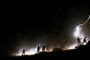 All bright on the Western Front: Artist uses bomb fuses to recreate eerily realistic World War One trench scenes with TOY soldiers<br /> <br /> They might only be toy soldiers - but the raging war around them looks eerily authentic. <br /> That's because the flying sparks, smoke and searing flashes of light illuminating them have all been created with real bomb-making equipment.<br /> Dave Farnham has blazed a trail in the art world by using explosive fuse wire to create his stunning photographs.<br /> <br /> He surrounds the miniature men, rocks and pieces of bark in his back garden with yards of the cord, lights it and takes long-exposure shots with his camera.<br /> The dazzling scenes are designed to replicate what battle might look like up close. They are also meant to blur the line between drawing and photography.<br /> Prize-winning artist Mr Farnham, 33, from Woodford Green, east London, started using fuse wire since earning his master's degree in fine art 10 years ago.<br /> <br /> 'I stumbled across fuse wire, as a medium, because I had been experimenting with sparklers and I wanted to be able to use a more malleable material that I could use to create lines and define light and shade within my compositions.<br /> 'I have a very basic set-up. I am not the best photographer in the world, but I know how to set my camera to get the right exposure for my shots. <br /> 'I use a Nikon D90 camera, lots of fuse wire, Woolworths toy soldiers, tripods and always have a bucket of water nearby.<br /> <br /> 'All my shoots are done outside, due to the volatility of the fuse wire, and are shot in the nighttime.<br /> 'I set fire to the fuse and take a long exposure photograph of the fuse being burnt, so I have no idea how the image will look until the camera has finished process the image.'<br /> Due to the terror risk, the biggest problem Mr Farnham has had with his work is buying the explosive cord.<br /> 'Initially, obtaining the fuse wire was very hard,' he explaine