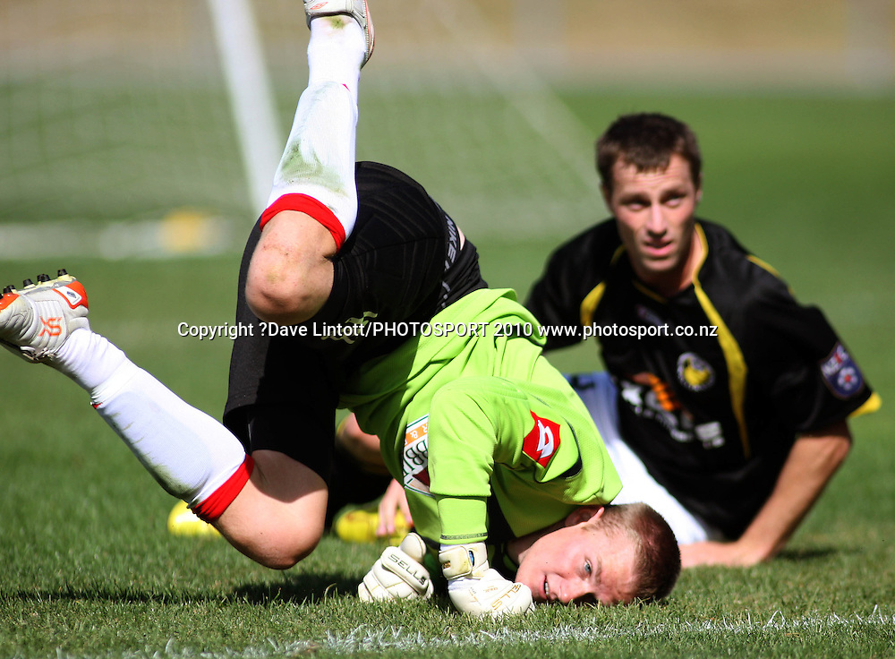 Canterbury keeper Tom Batty lands after colliding with Andy Barron.<br /> NZFC soccer  - Team Wellington v Canterbury United at Porirua Park, Wellington. Sunday, 14 March 2010. Photo: Dave Lintott/PHOTOSPORT