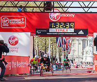 Marcel Hug of Switzerland leads Great Britain's David Weir over the line to win the Men's Wheelchair race at the Virgin Money London Marathon 2014 on Sunday 13 April 2014<br /> Photo: Roger Allan/Virgin Money London Marathon<br /> media@london-marathon.co.uk