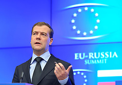 "Dmitry Medvedev, Russia's president, speaks during a press conference following the EU-Russia summit at the European Union council headquarters in Brussels, Belgium, on Tuesday, Dec. 7, 2010. Russia will move a step closer to membership in the World Trade Organisation today when it signs an agreement with the European Union settling ""key questions"" that have hampered its accession bid for years. (Photo © Jock Fistick)."