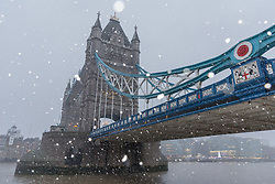 © Licensed to London News Pictures. 10/12/2017. London, UK. Heavy snow falls on Tower Bridge on the River Thames. Heavy snow has fallen across the UK this morning. Photo credit: Vickie Flores/LNP