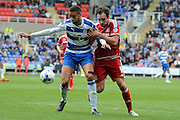 Middlesbrough striker Kike and Reading defender Michael Hector tussle for the ball during the Sky Bet Championship match between Reading and Middlesbrough at the Madejski Stadium, Reading, England on 3 October 2015. Photo by Alan Franklin.