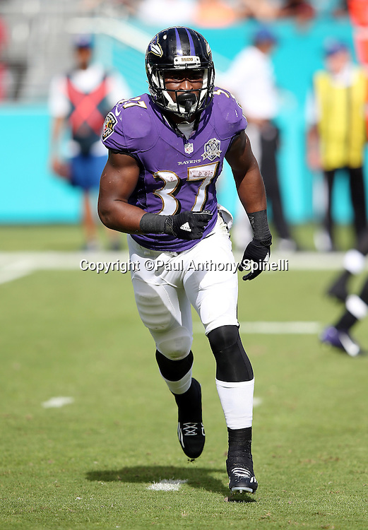 Baltimore Ravens running back Javorius Allen (37) goes in motion during the 2015 week 13 regular season NFL football game against the Miami Dolphins on Sunday, Dec. 6, 2015 in Miami Gardens, Fla. The Dolphins won the game 15-13. (©Paul Anthony Spinelli)
