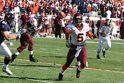 Virginia Tech quarterback Marcus Vick (5) throws ahead of Virginia defensive end Chris Long (91).  The Virginia Tech Hokies defeated The Virginia Cavaliers 52-14 on November 19, 2005 at Scott Stadium in Charlottesville, VA.