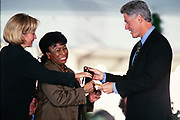 Jazz vocalist Betty Carter is presented the National Medal of the Arts by President Bill Clinton and First Lady Hillary Clinton during a ceremony on the South Lawn of the White House September 29, 1997 in Washington, DC.