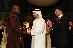 Kenyan Peter Tabichi (left) teacher at Keriko Secondary School in Nakuru, Kenya receives his «Global Teacher Prize 2019» from Dubai's Crown Prince Shaikh Hamdan Bin Mohammad bin Rashid Al Maktoum (center) in Dubai, United Arab Emirates, on March 24, 2019. The Global Teacher Prize serves to underline the importance of educators and the fact that, throughout the world, their efforts deserve to be recognised and celebrated. The US $1 million award from the Varkey Foundation is presented annually to an exceptional teacher who has made an outstanding contribution to their profession. Photo by GESF-Balkis Press/ABACAPRESS.COM