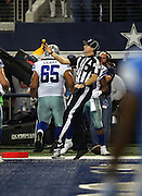 Side judge Allen Baynes (56) throws a yellow flag in the air after Dallas Cowboys running back DeMarco Murray (29) runs for a third quarter touchdown negated by the penalty during the NFL week 18 NFC Wild Card postseason football game against the Detroit Lions on Sunday, Jan. 4, 2015 in Arlington, Texas. The Cowboys won the game 24-20. ©Paul Anthony Spinelli