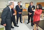 L-R: Felix Fraga, Dr. James Benfield, Rudy Trevino, principal Eduardo Sindaco and trustee Juliet Stipeche tour a classroom at The Rusk School, April 7, 2014.