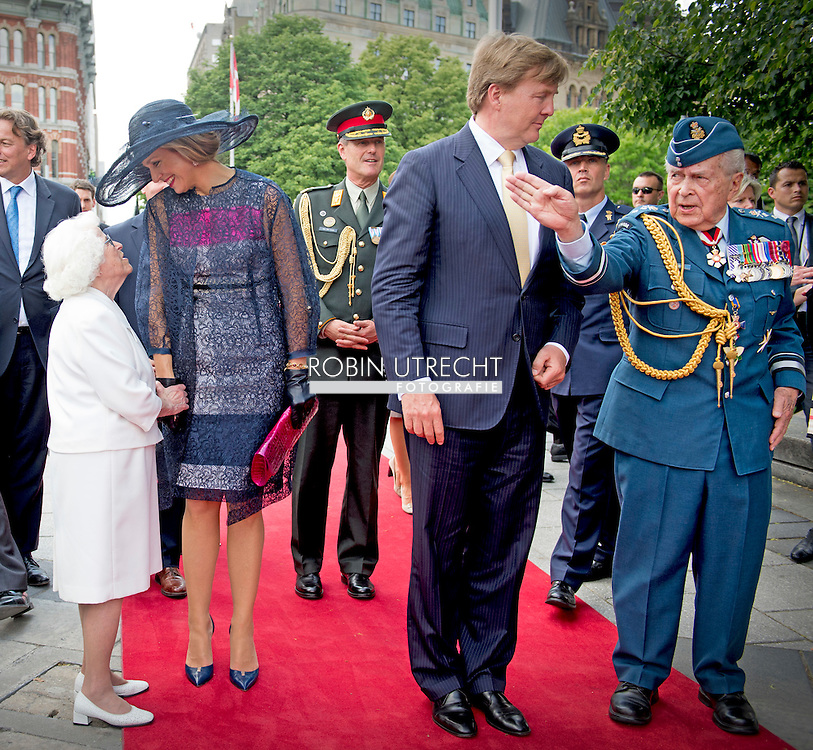 King Willem-Alexander and Queen Maxima of The Netherlands meet Canadian veterans at the National Arts Center in Ottawa, Canada, 27 May 2015. The King and Queen of The Netherlands bring an state visit from 27 till 29 may to Canada. COPYRIGHT ROBIN UTRECHT