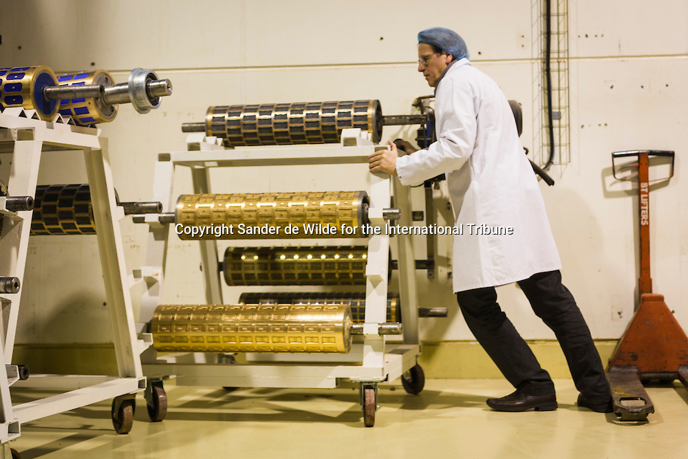 Belgium, Eeklo (80 km N-W of Brussels) February 8, 2011. The Willemsbiscuits factory. Marc Willems rearranging the templates for all the cookies. These press all different forms in the cookies.copyrights © Sander de Wilde for the International Tribune.