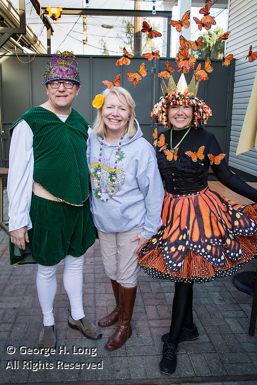 Boss Jim Hobbs, Krewe Captain Peggy Scott Laborde, and Queen Tracy Thomson at the Phunny Phorty Phellows annual meeting at Grits