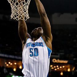 December 26, 2010; New Orleans, LA, USA; New Orleans Hornets center Emeka Okafor (50) dunks against the Atlanta Hawks during the first quarter at the New Orleans Arena.  Mandatory Credit: Derick E. Hingle