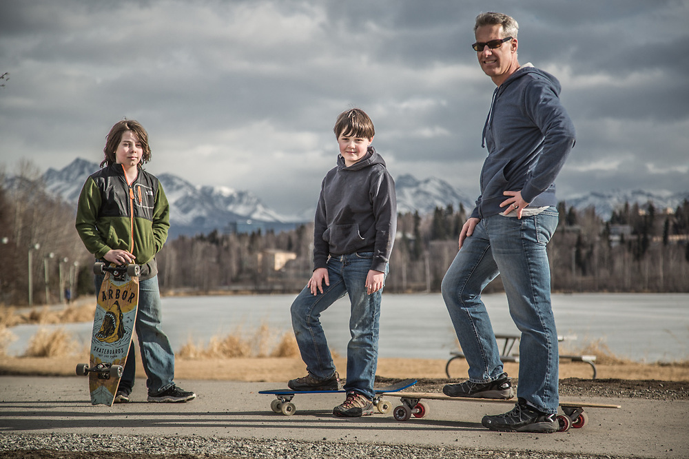 "Stay at home dad Sean Johnson with his sons Brynn (9) and Aidan (11) near Westchester Lagoon.  ""This is our first time out on our boards…its a bit early as there is still some ice on the trail."""