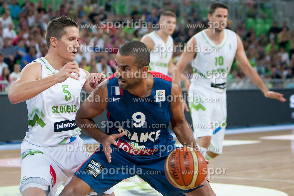 Jaka Lakovic of Slovenia and Tony Parker of France during last friendly match before Eurobasket 2013 between National teams of Slovenia and France on August 31, 2013 in SRC Stozice, Ljubljana, Slovenia. (Photo by Urban Urbanc / Sportida.com)