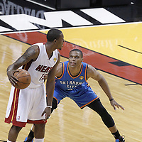 17 June 2012: Oklahoma City Thunder point guard Russell Westbrook (0) defends on Miami Heat point guard Mario Chalmers (15) during the Miami Heat 91-85 victory over the Oklahoma City Thunder, in Game 3 of the 2012 NBA Finals, at the AmericanAirlinesArena, Miami, Florida, USA.