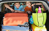 Portrait of boys (6-11) in loaded car