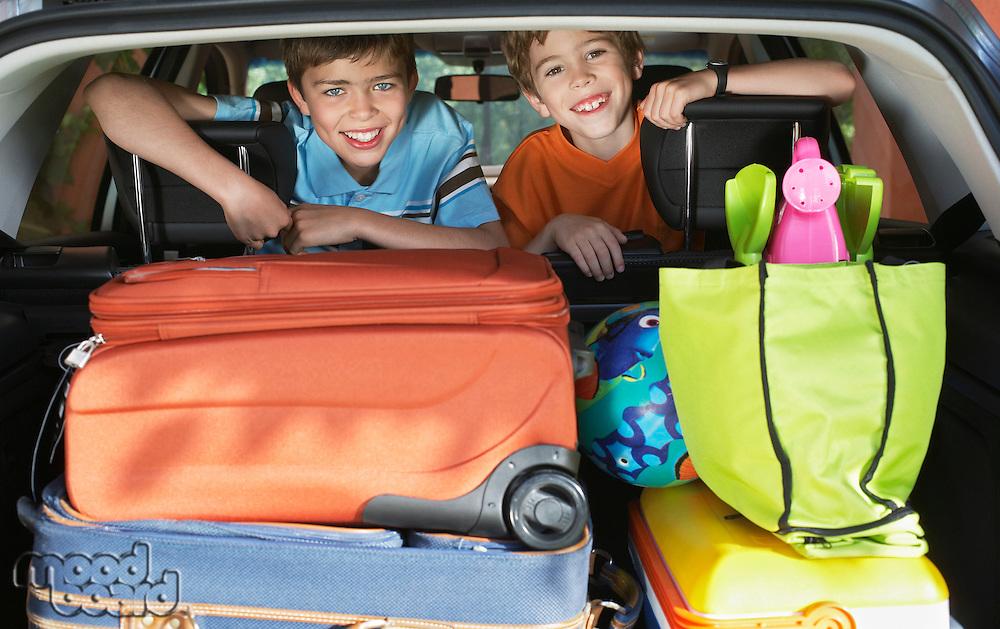 Portrait of boys (6-11) in loaded car