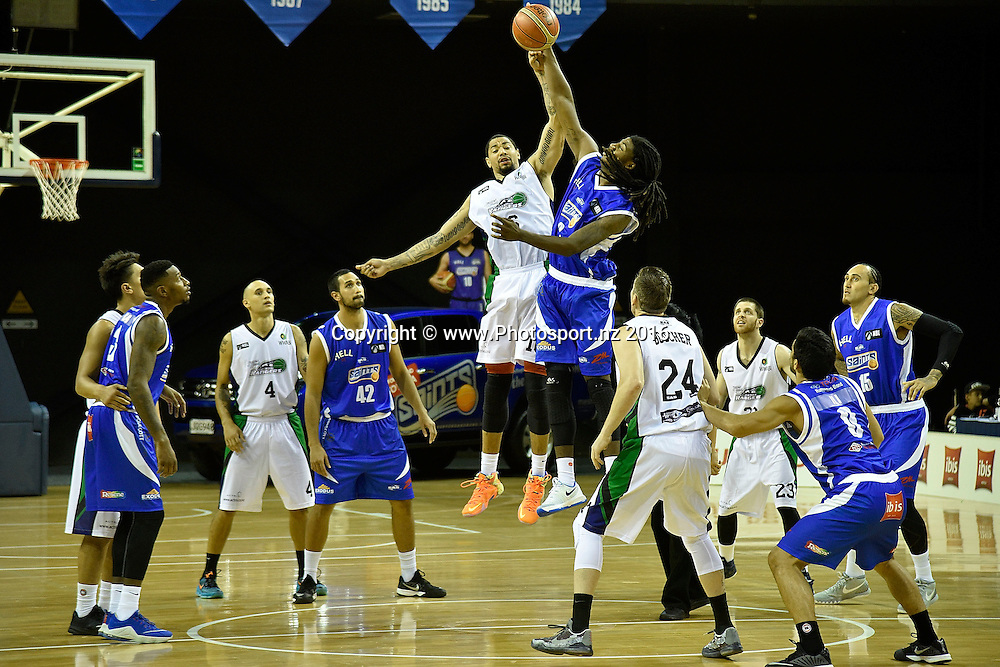 Terrence Robberts (Centre L) of the Rangers jumps for the ball with Charles Jackson (Centre R) of the Saints during the NBL Wellington Saints vs Super City Rangers basketball match at the TSB Arena in Wellington on Thursday the 10th of March 2016. Photo by Marty Melville / www.Photosport.nz