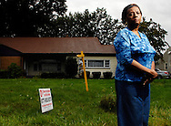 Rose Carter stands in front of her now empty home  in Liberty Township, OH. Carter was unable to keep up with payments after her interest rates rose...Youngstown Ohio...Photo by Ken Blaze