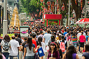 "22 DECEMBER 2012 - SINGAPORE, SINGAPORE:  The crowd on Orchard Road during the Christmas on a Great Street in Singapore. Orchard Road, Singapore's famed shopping street, sponsors the annual event, called ""Christmas on a Great Street."" The street is decorated with holiday lights, stores stay open late and crowds pack the area. This is the 8th year Singapore has held the ""Christmas on a Great Street"" event.   PHOTO BY JACK KURTZ"