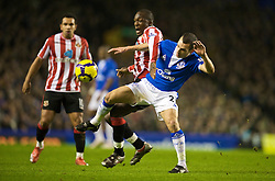 LIVERPOOL, ENGLAND - Wednesday, January 27, 2010: Everton's Leon Osman and Sunderland's Nyron Nosworthy in action during the Premiership match at Goodison Park. (Photo by: David Rawcliffe/Propaganda)
