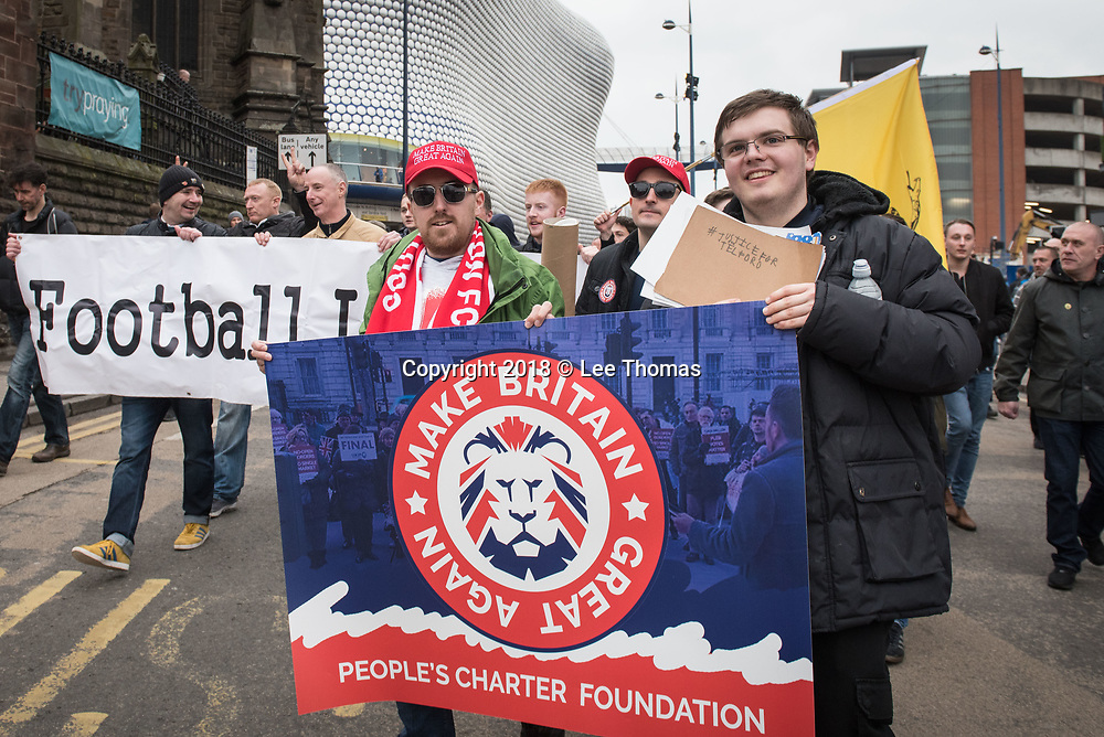 Birmingham, West Midlands, UK. 24th March 2018. Thousands of demonstrators converge on Birmingham city centre organised by three individual groups: Football Lads Alliance (FLA), Democratic Football Lads Alliance (DFLA) and Stand Up To Racism.  Pictured: Supporters of the FLA march past the iconic Selfridges building. // Lee Thomas, Tel. 07784142973. Email: leepthomas@gmail.com  www.leept.co.uk (0000635435)