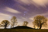 Orion over Navan Fort, an ancient monument in County Armagh, Northern Ireland. According to Irish mythology, it was one of the great royal sites of pre-Christian Gaelic Ireland and the capital of the Ulaidh.