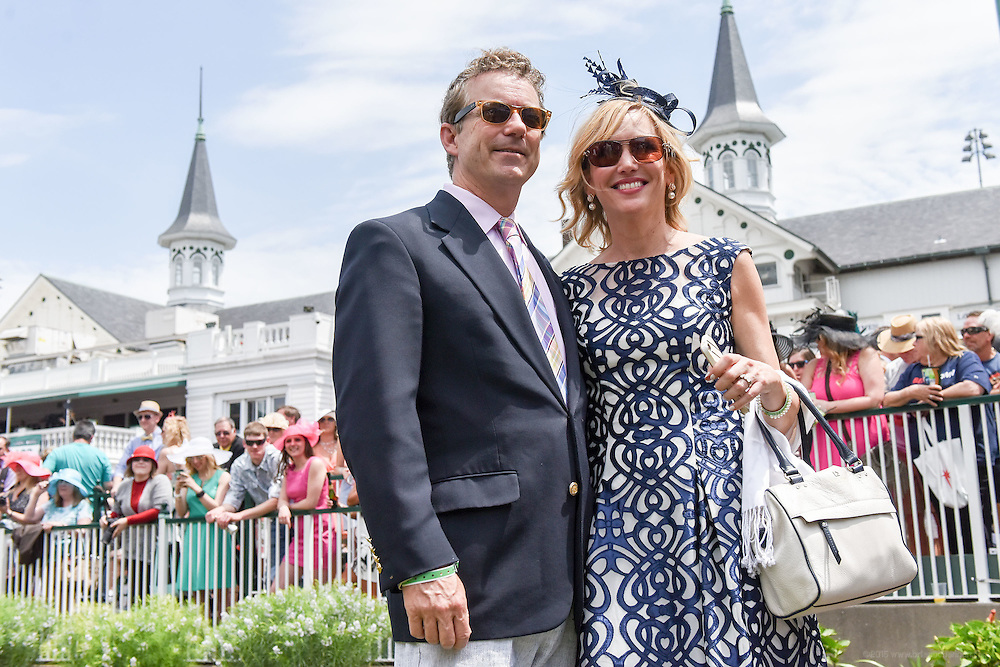 Senator Rand Paul and his wife Kelley are photographed by a friend as they stand in the paddock at the 142nd running of the Kentucky Derby. May 7, 2016
