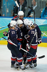 Olympic Winter Games Vancouver 2010 - Olympische Winter Spiele Vancouver 2010, Ice Hockey (Women's Preliminary Round), Eishockey, Team USA rallies together after scoring there eighth unanswered goal during the first game of the women's hockey event at the University of British Columbia's Thunderbird Arena as USA took on China during the 2010 Winter Olympics in Vancouver, British Columbia, on Sunday, Feb. 14, 2010.  The USA went on to win 11-1. *Photo by newsport  / HOCH ZWEI / SPORTIDA.com.