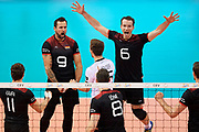 Poland, Krakow - 2017 September 03: (L) Georg Grozer and Denys Kaliberda with their team mates celebrate winning point while final match between Germany and Russia  during Lotto Eurovolleyball Poland 2017 - European Championships in volleyball at Tauron Arena on September 03, 2017 in Krakow, Poland.<br /> <br /> Mandatory credit:<br /> Photo by &copy; Adam Nurkiewicz<br /> <br /> Adam Nurkiewicz declares that he has no rights to the image of people at the photographs of his authorship.<br /> <br /> Picture also available in RAW (NEF) or TIFF format on special request.<br /> <br /> Any editorial, commercial or promotional use requires written permission from the author of image.