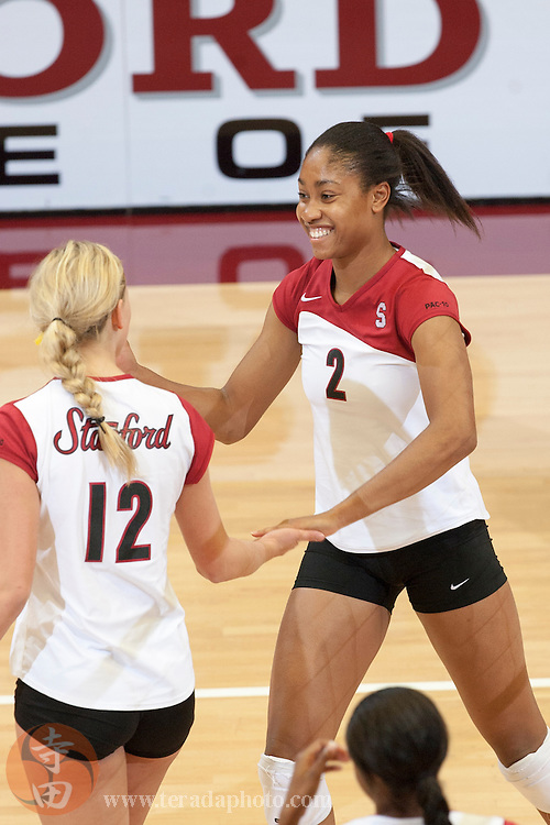 November 25, 2006; Stanford, CA, USA; Stanford Cardinal outside hitter Erin Waller (12) and middle blocker Janet Okogbaa (2) celebrate during the game against the Washington State Cougars at Maples Pavilion. The Cardinal defeated the Cougars 30-27, 30-23, 30-18.
