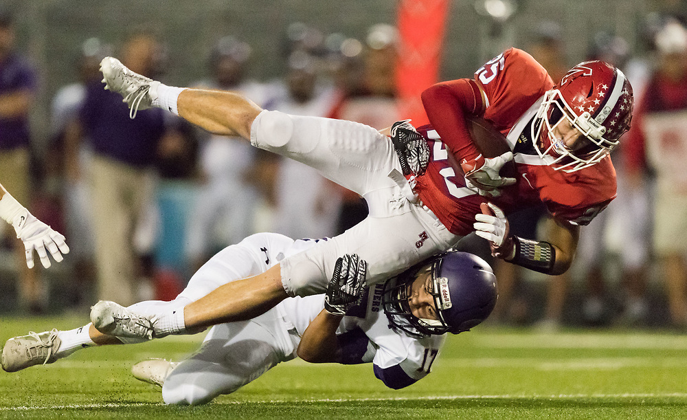 Millard South's Tyson Gerdes is tackled by Grand Island's Keyin Wentling in the first half. Millard South played Grand Island in a football game at Buell Stadium on Friday, Sept. 29, 2017, in Omaha.<br /> <br /> MATT DIXON/THE WORLD-HERALD